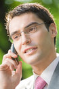 Businessman with cellphone Stock Image