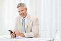 Businessman at cellphone happy smiling mature using phone workplace Royalty Free Stock Images
