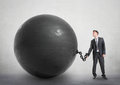 Businessman chained to a large ball metal Royalty Free Stock Image