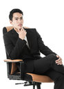 Businessman on a chair thinking Royalty Free Stock Photo