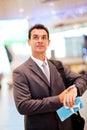 Businessman checking flight time Royalty Free Stock Photo