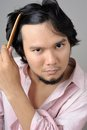 Businessman checking hairline problems asian Royalty Free Stock Image