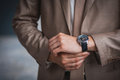 Businessman checking the time on his wrist watch Royalty Free Stock Photography