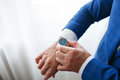 Businessman checking time on his wristwatch. men`s hand with a watch. Royalty Free Stock Photo