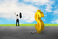 Businessman cheering for free from dollar sign shackle Fotos de Stock