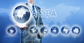 Businessman choosing asia continent on virtual digital screen business concept of decision making Stock Photography