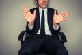 Businessman with clean conscience in office chair showing his palms to convey a Royalty Free Stock Images