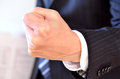 Businessman clenching his hand with the fingers Royalty Free Stock Image