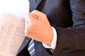 Businessman clenching his hand with the fingers Stock Images