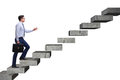 The businessman climbing career ladder in business concept