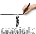 Businessman climbing in drawing world Stock Photo