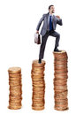 Businessman climbing gold coins Stock Images