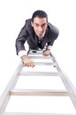 Businessman climbing the ladder isolated on white Royalty Free Stock Images