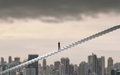 Businessman climbing on ladder over city looking ahead, Leadership concept Royalty Free Stock Photo
