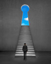 Businessman climbing on stair to key shape door with blue sky Royalty Free Stock Photo