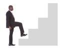 Businessman climbing steps Royalty Free Stock Photo
