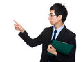 Businessman with clipboard and finger point aside isolated on white Royalty Free Stock Images