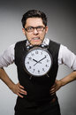 Businessman with clock in time concept Stock Image