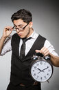 Businessman with clock in time concept Stock Photos