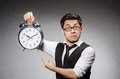 Businessman with clock in time concept Royalty Free Stock Images