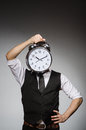 Businessman with clock in time concept Royalty Free Stock Photography