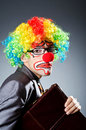 Businessman with clown wig Royalty Free Stock Photos