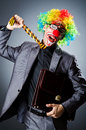 Businessman with clown wig Stock Images