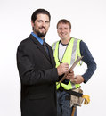 Businessman and construction worker posing for the camera Royalty Free Stock Image