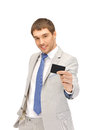 Businessman with credit card bright picture of happy Stock Photography