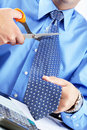 Businessman cutting the tie Royalty Free Stock Photo