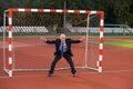 Businessman defending goal Royalty Free Stock Image