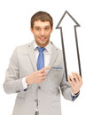 Businessman with direction arrow sign picture of attractive Royalty Free Stock Photo