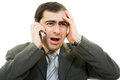 Businessman in distress speaks by phone Stock Images