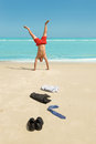 Businessman doing handstand on the beach Royalty Free Stock Photo