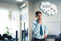 Businessman doing mental arithmetic young in the office Stock Photo