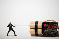 Businessman dragging big bomb with timer Royalty Free Stock Photo