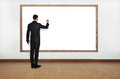 Businessman drawing on blank blackboard Stock Photo