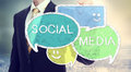 Businessman drawing social media speech bubbles colorful Royalty Free Stock Images