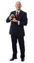 Businessman dropps pound in golden pig Stock Photography