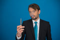 Businessman with e cigarette wearing suit and tie on blue handsome background Stock Photos