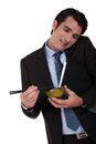 Businessman eating chinese food for lunch Stock Image