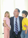 Businessman embracing son and daughter smiling Stock Photography