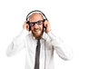 Businessman enjoying rock music still listening to hard Royalty Free Stock Images