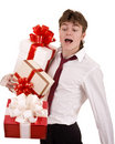 Businessman with falling gift box. Royalty Free Stock Photo