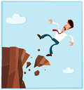 Businessman falling from the side of cliff getting failed and as a metaphor Stock Photography