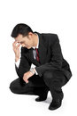 Businessman feeling down young handsome upset kneel and holding his forehead full body isolated on white background Royalty Free Stock Photography