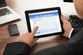 Businessman filling online job application close up of on digital tablet Royalty Free Stock Photo