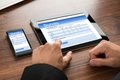 Businessman filling survey form close up of a online on digital tablet and cellphone Royalty Free Stock Image
