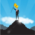 Businessman with flag on mountain top