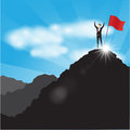 Businessman with flag on mountain top.